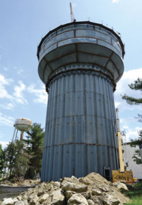 Hour photo / Erik Trautmann The First Taxing District's $7 million project to replace the water tower and pumping station at 34 Grandview Ave. is well underway. The project will also include repainting of the old three-million water tank.